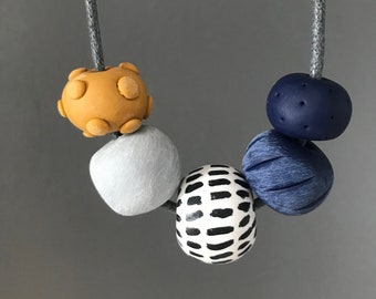 Navy and mustard modern clay necklace on adjustable cotton cord, clay beaded necklace, statement necklace