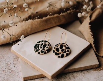 Geometric statement earrings in black and taupe with brass circle detail, black spotty earrings, hand painted animal print hoops