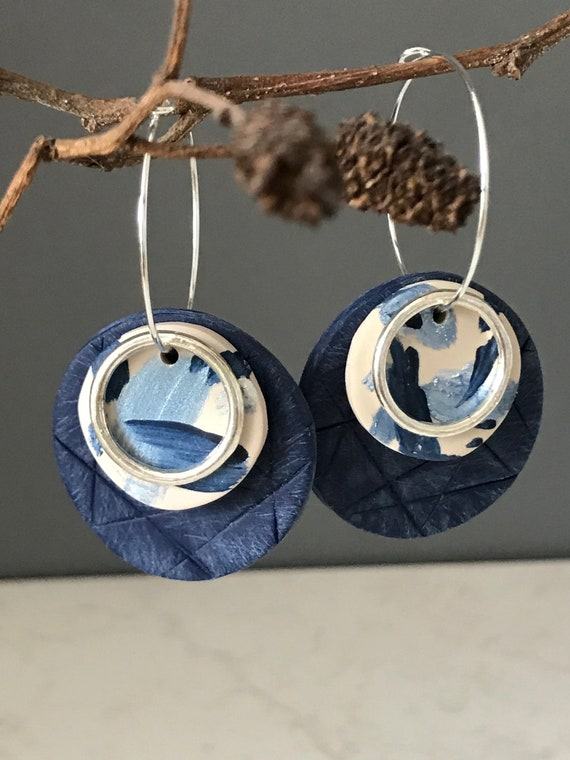 Hand painted clay earrings in blue and cream, abstract clay earrings, handmade earrings on silver hoops