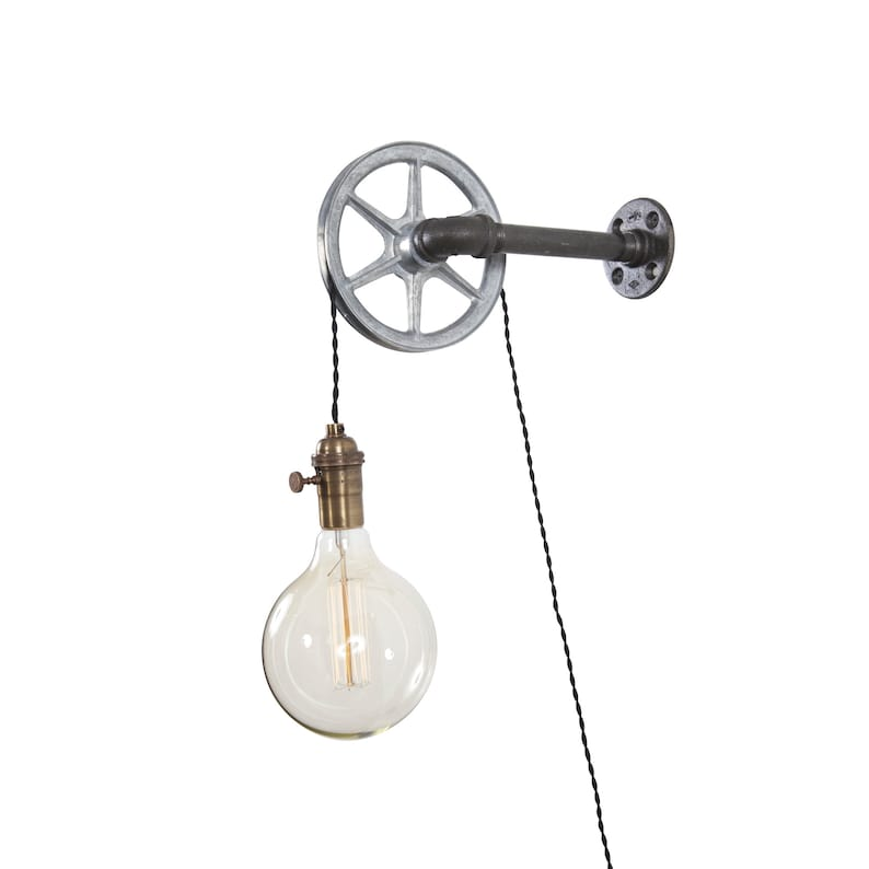 Steel pulley and vintage cloth wire wall light / industrial image 0