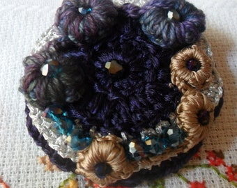 Brooch crocheted pale silk