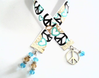 Peace Ribbon Bookmark, Peace Sign Charm, 1960s Hippie Book Jewelry, Woodstock Era Peace Sign Pattern Fabric in Aqua Black Gold and White
