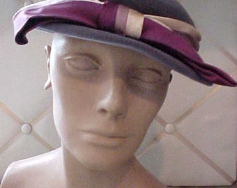 1940 Grey felt hat with Purple, lavender and peach band and bow.  Size 22 1/2  H46