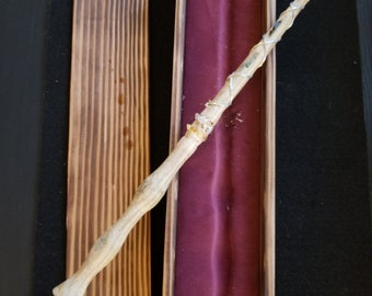 Hand made white oak wand gem encrusted, with red velvet finished case.