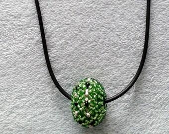 Disco ball necklace.