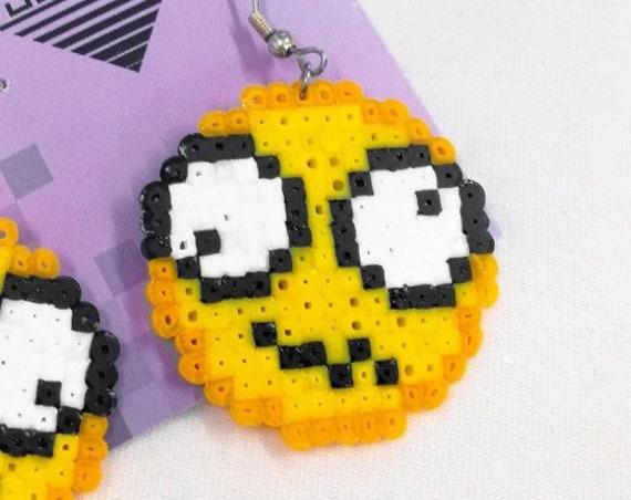 Dizzy emoticon earrings