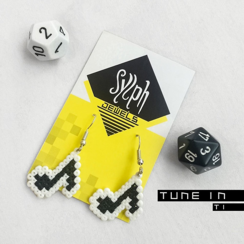 Pixelated black and white music lover earrings called Tune In with Ti  (quaver) notes in 8bit retro games' style ready to rock'n'roll