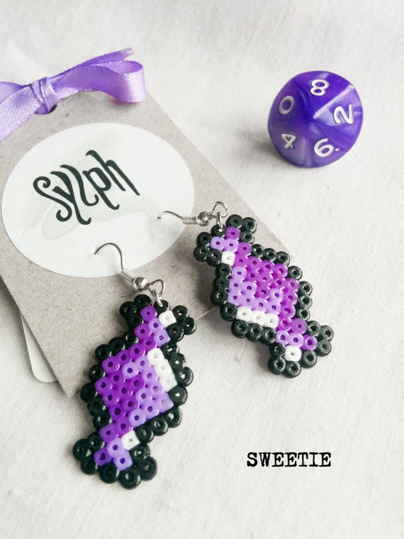 Shades of purple pixelated Sweetie earrings with an 8bit retro vibe made of Hama Mini Perler Beads, perfect for candy fans!