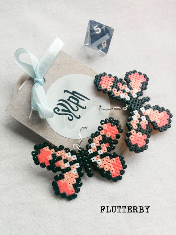 Pixelated Flutterby earrings in rose quartz, made of Hama Mini Perler Beads in retro games' style for butterfly lovers!