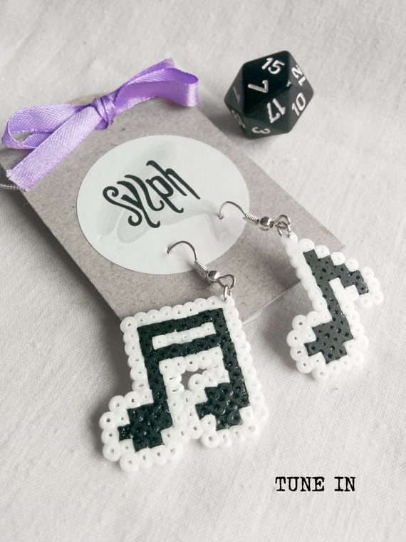 Pixelated black and white music lover earrings called Tune In in 8bit retro games' style ready to rock'n'roll