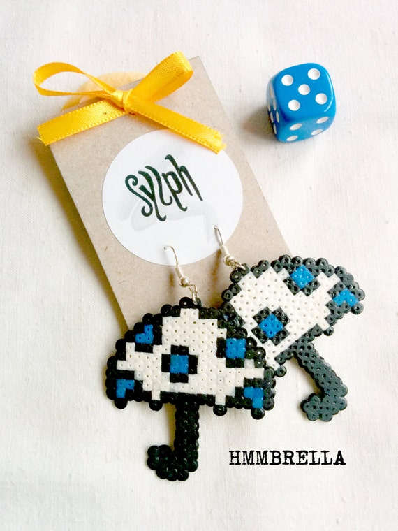White pixelated 8bit umbrella earrings with blue polkadots, perfect for rainy days and autumn weather