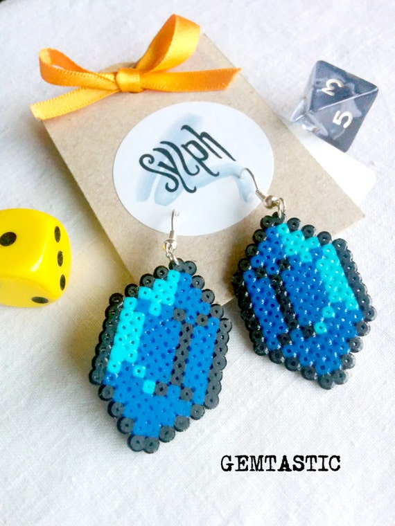 Blue with a turquoise shine geeky 8bit retro Zelda game inspired Gemtastic earrings in an emerald shape made of Hama Mini Perler Beads