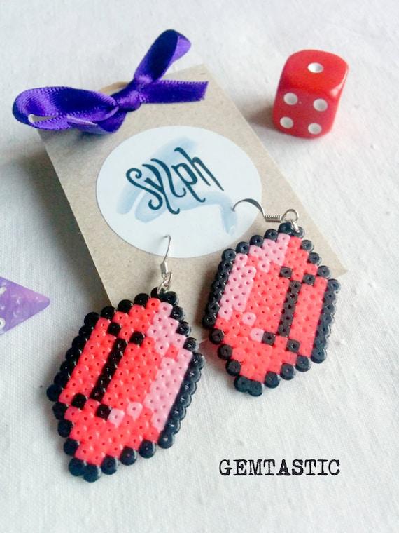 Bright pink geeky 8bit Zelda game inspired Gemtastic earrings in an emerald shape made of Hama Mini Perler Beads