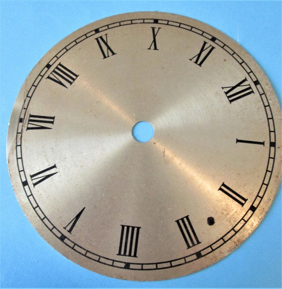 "1  5 1/2"" Brass Colored Aluminum Clock Dial with 1/2"" Black Roman Numerals"