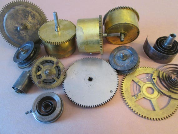 12 Piece Lot of Antique Clock Mainsprings, Gears , and Wheels for your Clock Projects - Steampunk Art - and Etc...