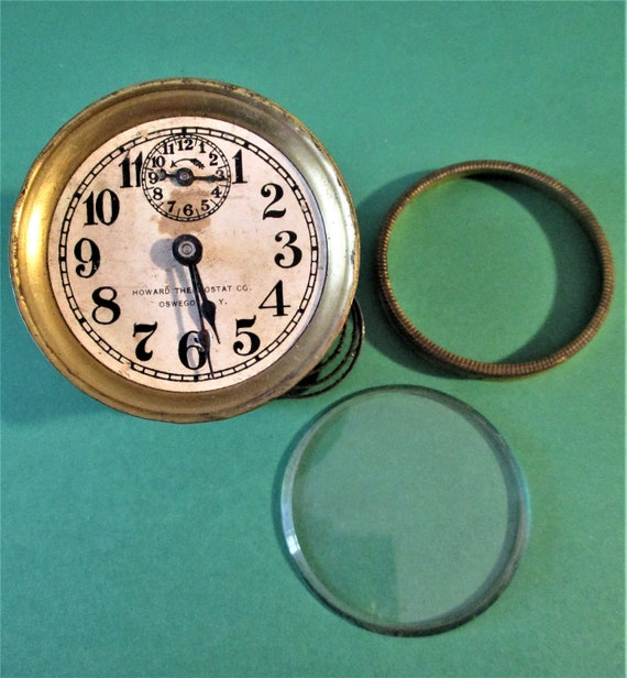 """2 1/4"""" Antique Howard Thermostat Co. Partial Clock Works for Repairs/Parts Stk# 694"""