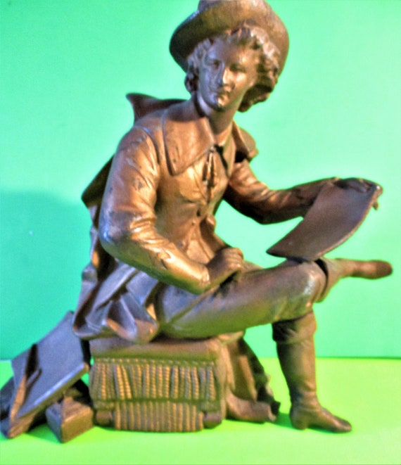 """Vintage 9 1/2"""" Tall light Brass Colored Painted Cast Metal Sitting Man with Books Clock Topper/Art Statue"""