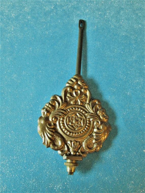 """6 1/4""""  Fancy Cast Metal Kitchen Clock Pendulum 3.2 ounces - Reproduction - Stk# 731"""