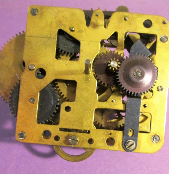 """Old Partial 2 1/2"""" x 2 1/2"""" Brass Clock Works with Attached Parts for your Clock Projects, Steampunk Art and Etc.."""