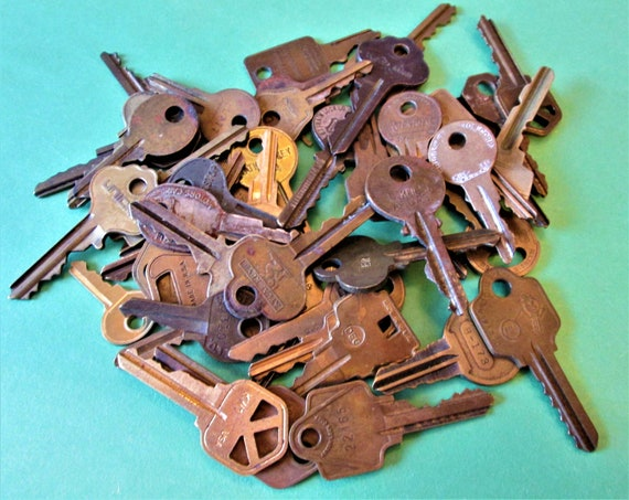 50 Vintage Brass Keys -  Different Makers - Great for Steampunk - Metelworking Projects - Jewelry Making and Etc. Stock Photo