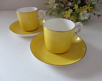 Royal Worcester 1900's  yellow coffee or demitasse cup and saucer