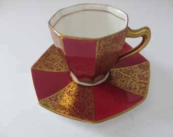 Royal Doulton 1930's red and gold coffee cup and saucer
