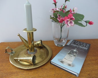 Victorian brass on copper chamber stick and candle snuffer.