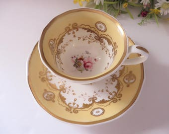 Antique Samuel Alcock 1800's creamy yellow  floral cup and saucer