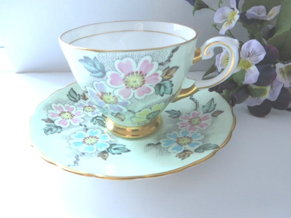Tuscan 1940's green floral coffee cup and saucer