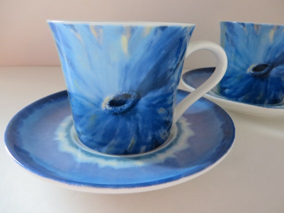 Royal Worcester  Nel Whatmoreset of two blue teacups and saucers