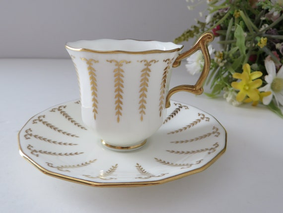 Cauldon 1900's Demitasse white and gold cup and saucer