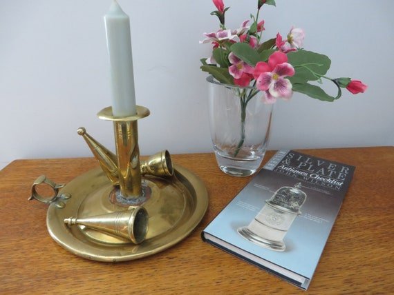 Victorian brass on copper chamberstick and candle snuffer.