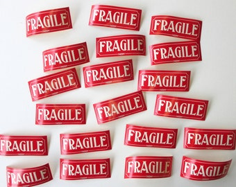 """Vintage """" FRAGILE """" Gummed Labels from the 1950s or early 1960s. Unused. Lot of 20. Shipping & mailing supplies. Craft. Scrapbooking. Etc."""