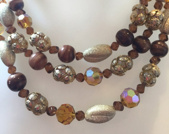 beautiful three stranded vintage Amber and gold glass beaded necklace signed by Vendome