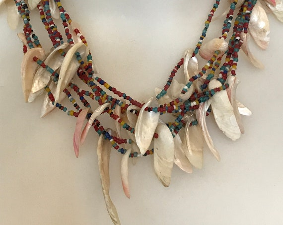 Unusual vintage tribal style multi strand seed beaded necklace with shell fringe