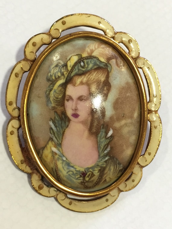 A striking vintage portrait brooch in enamel surround by Thomas L. Mott