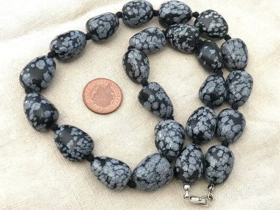 A Beautiful vintage natural polished Snowflake Obsidian handknotted beaded necklace