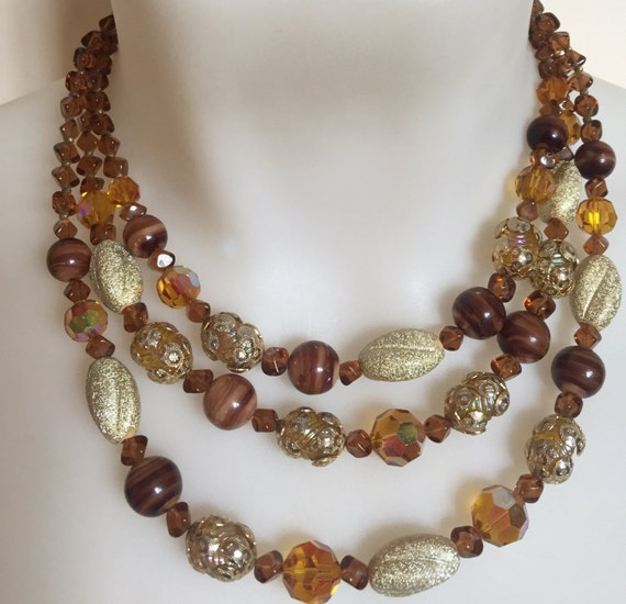 beautiful three stranded vintage amber snd gold glass beaded necklace by Vendome