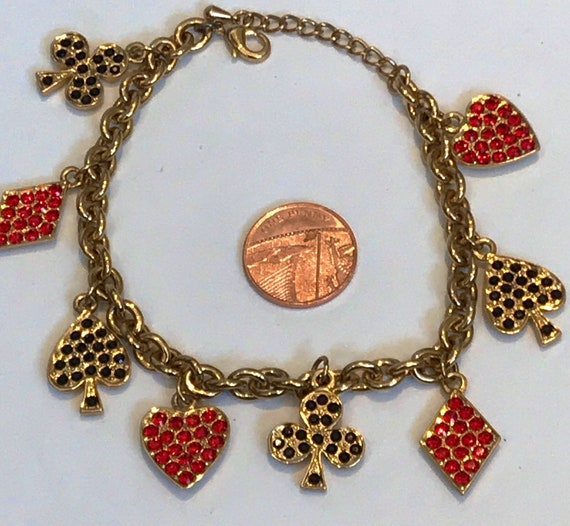 Beautiful vintage gold plated heavy charm bracelet with red and black crystal playing card charms Hearts,Clubs,Spades and diamonds