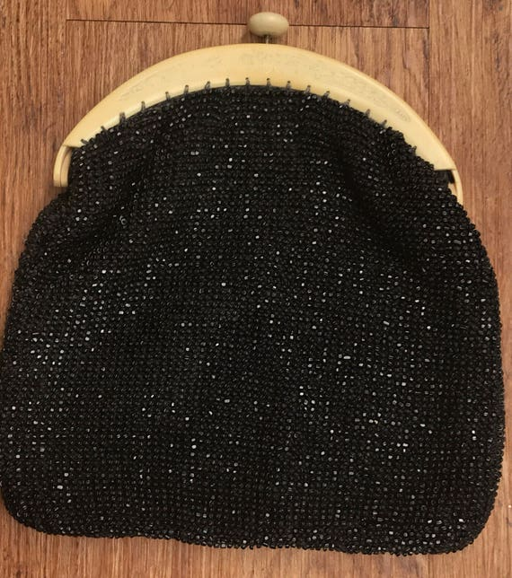 Beautiful black beaded 1920s Art Deco clutch evening bag carved celluloid push clasp handle