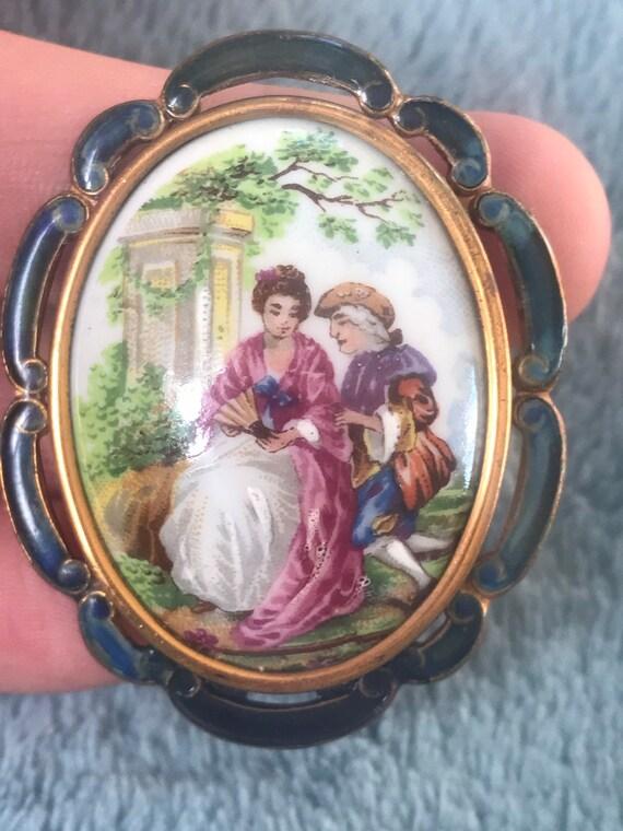 A striking vintage scenic  brooch in enamel surround by Thomas L. Mott