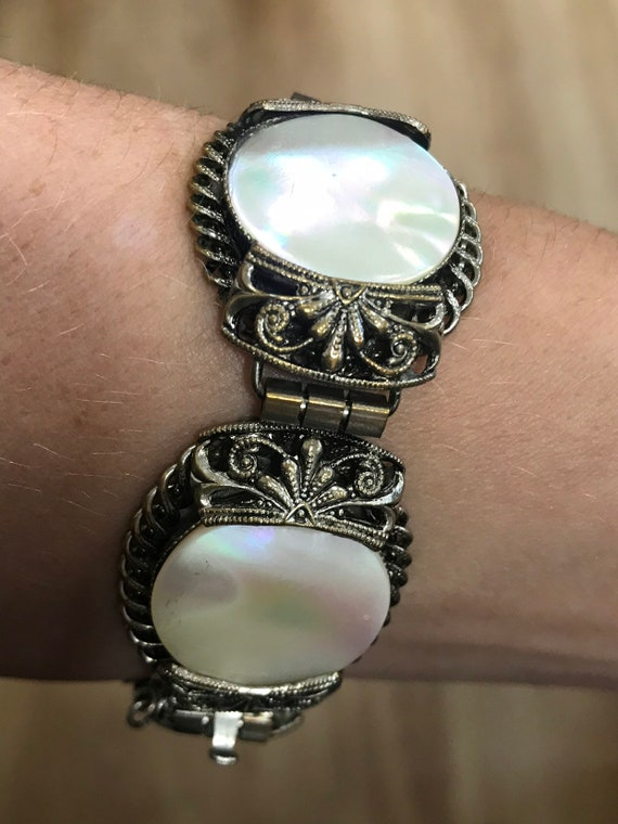 large statement piece Art Deco era mother of pearl and ornate filigree bracelet