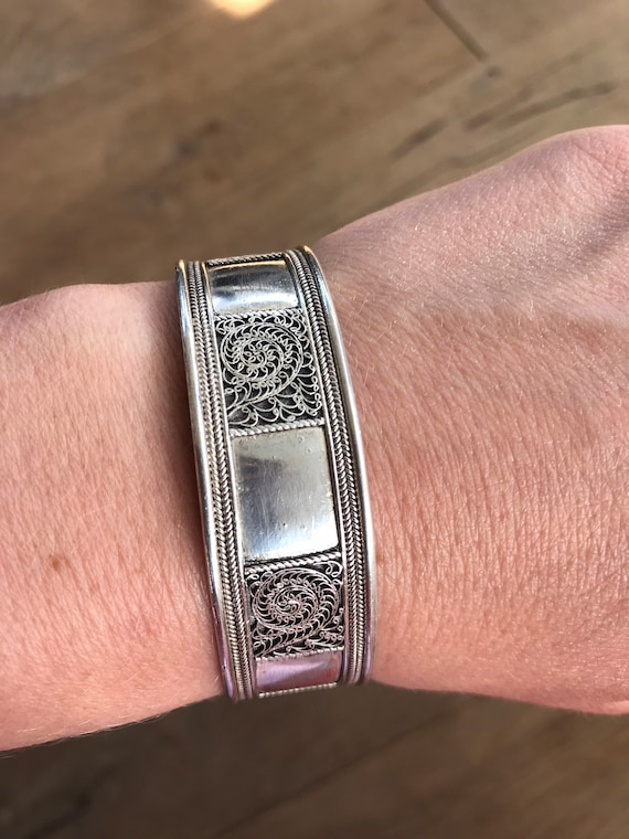 Solid silver vintage ethnic cuff bracelet with filigree scroll details