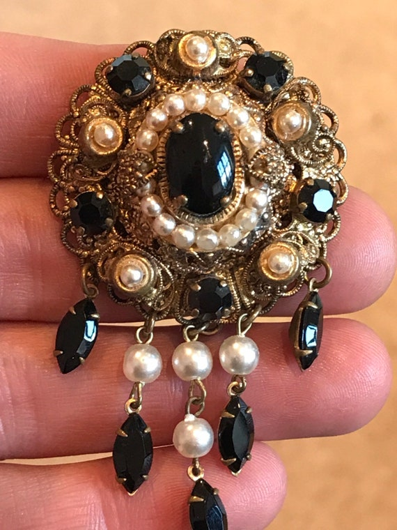 Vintage 1950s black glass and faux pearl Victorian revival drop brooch.