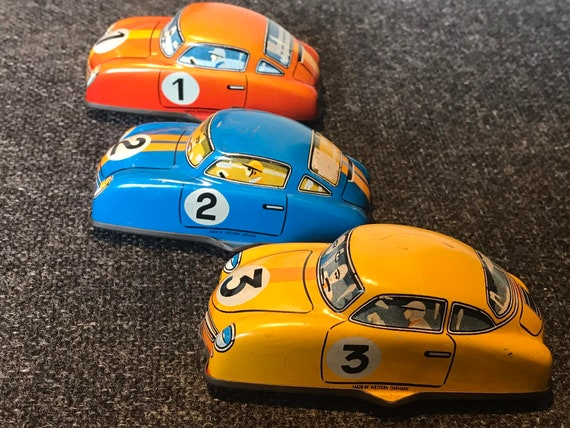 3 Original vintage tin lithograph wind up tin toy racing cars.