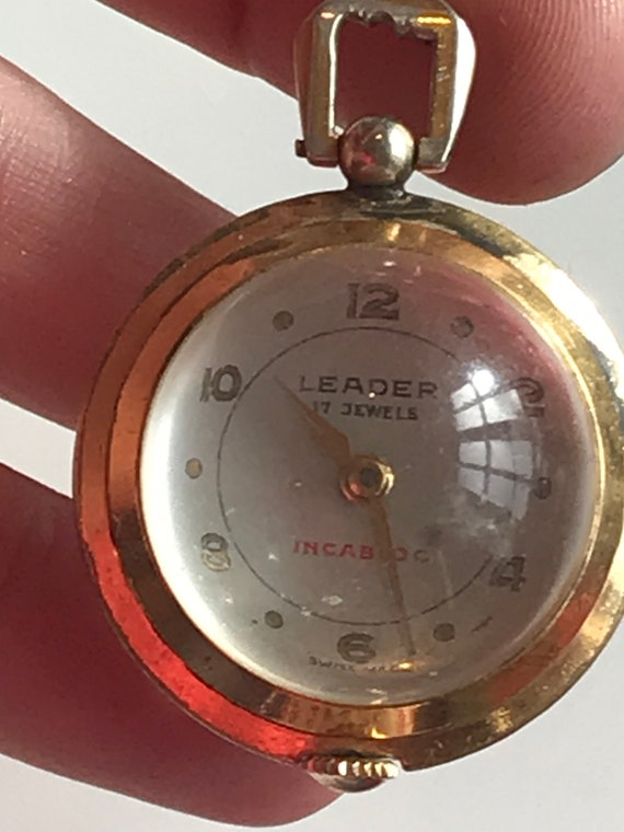 Vintage gold plated crystal ball pendant watch with clear Skeleton back by Leader