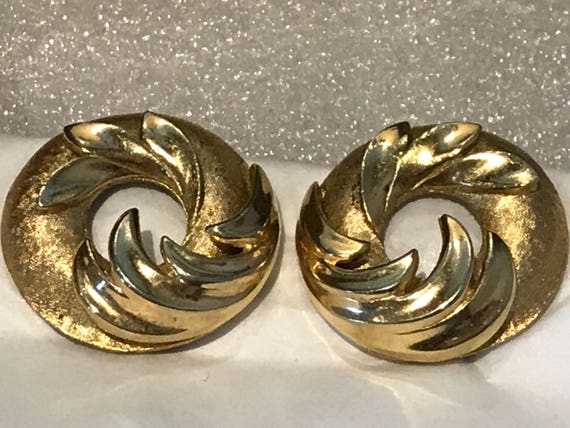 A beautiful pair of vintage clip-on earrings by makers Trifari crown logo