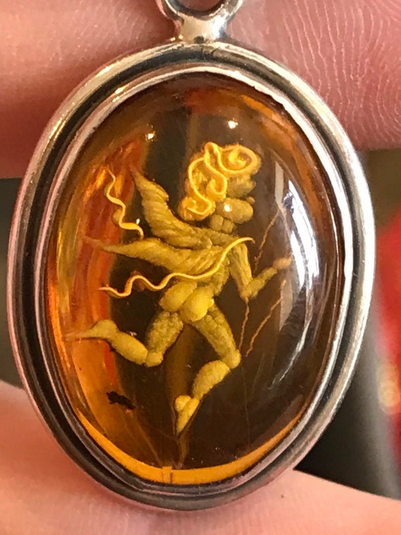 Vintage silver and Baltic carved Amber oval Cupid cherub Angel pendant