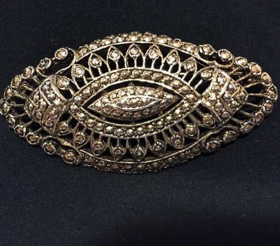 A striking vintage  gold tone marcasite ladies brooch pin by KIGU
