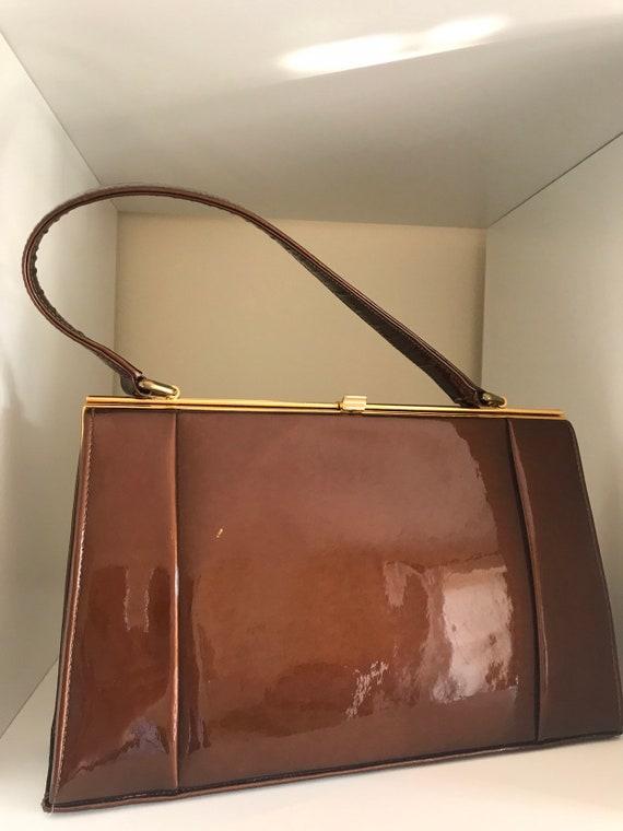 Vintage Holmes of Norwich deep caramel coloured patten leather kelly style handbag framed 1950-60sc